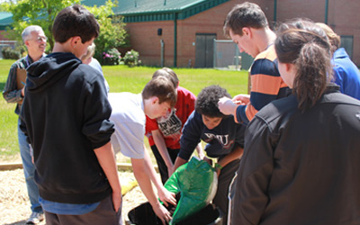 Middle school students dove into the project by helping Clemson students plant the trees and shrubbery in and around the finished garden.