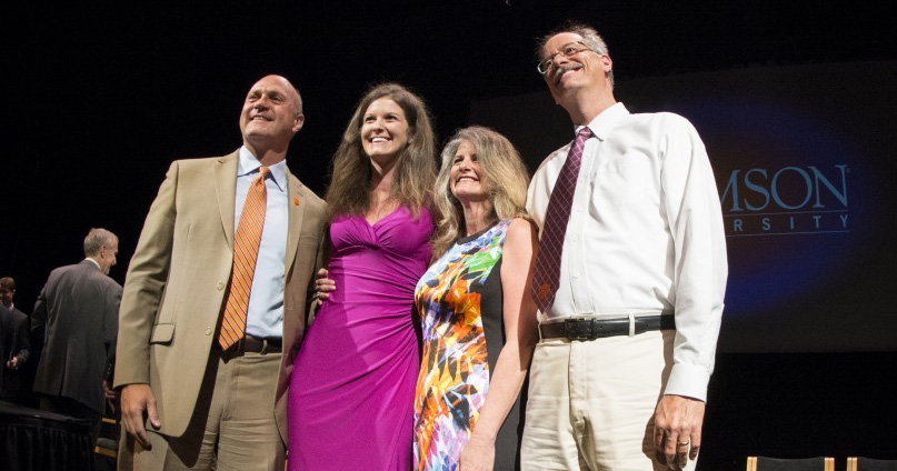 Brittany Ann Avin (in pink) poses with her parents and Clements after receiving the Norris Medal