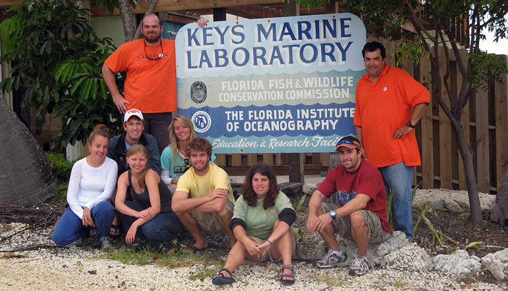 Photo of Dr. Childress and team in front of the Keys Marine Laboratory
