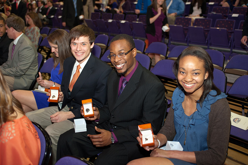 Seniors receive their Clemson class rings from President Barker during a ceremony at Littlejohn Coliseum.